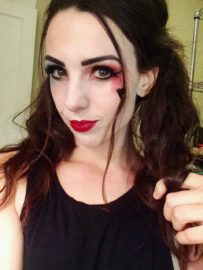 Cameron Evans with Harley Quinn makeup. Photo by Cameron Evans.